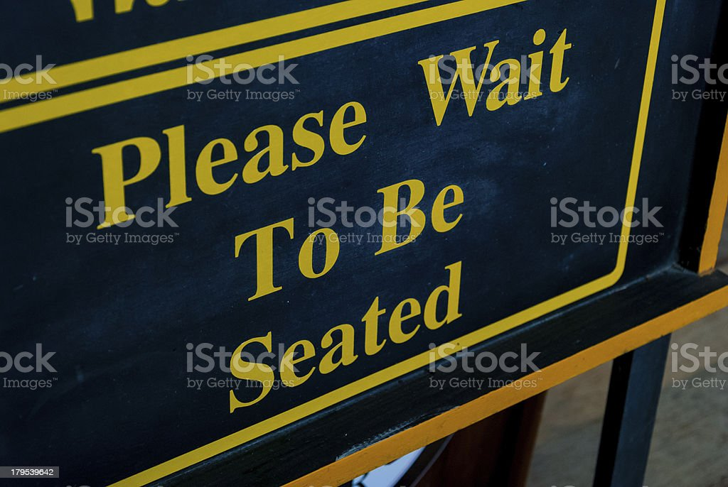 Please Wait To Be Seated Sign royalty-free stock photo