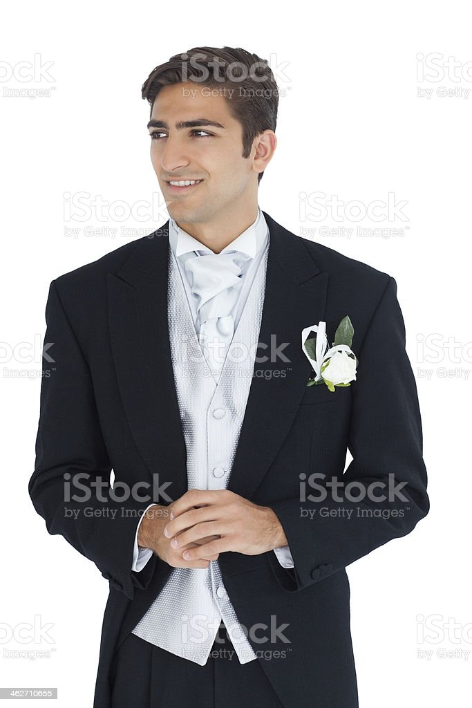 Pleased attractive young groom looking away stock photo