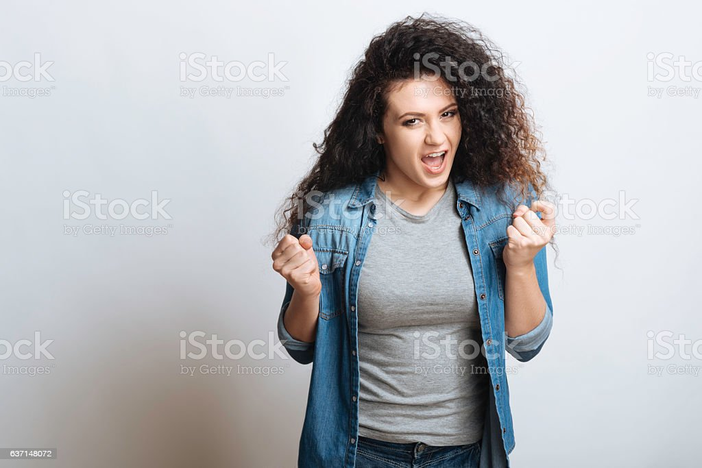 Pleased girl feeling satisfaction and happiness. stock photo