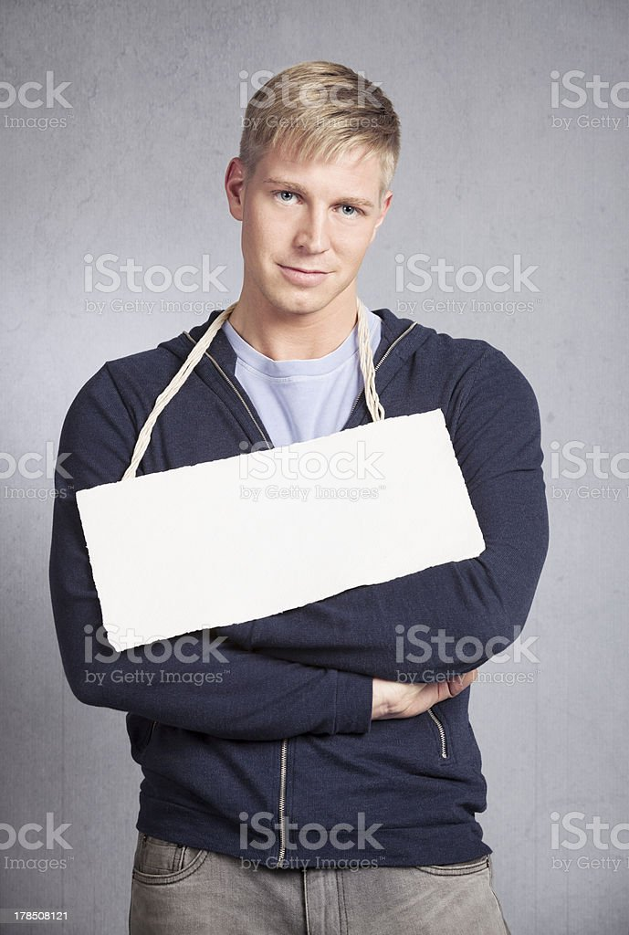 Pleased man presenting blank signboard. royalty-free stock photo