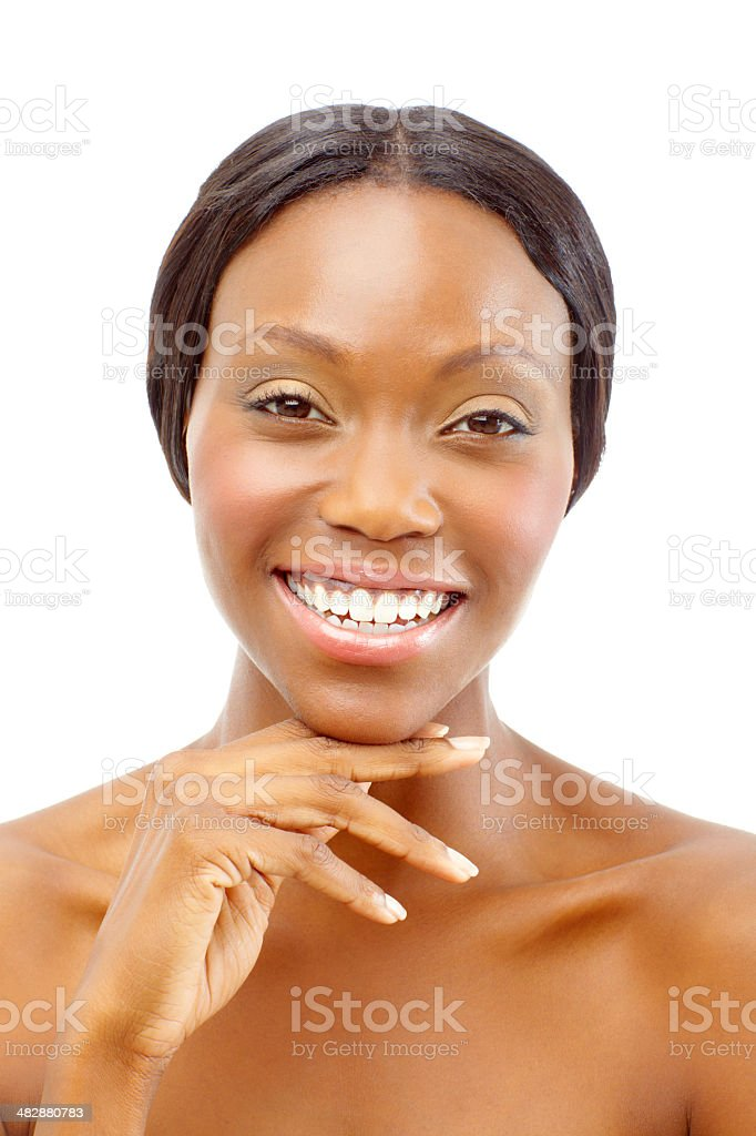 Pleased with the end result of her make-up session royalty-free stock photo