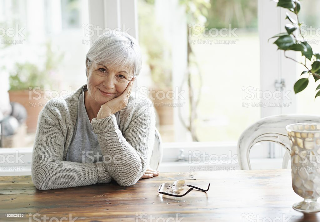 Pleased with the life she's created stock photo