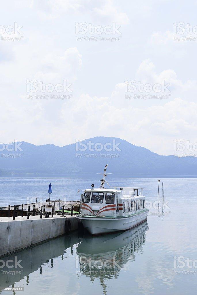 Pleasure boat in the Lake Tazawa (XXXLarge) stock photo