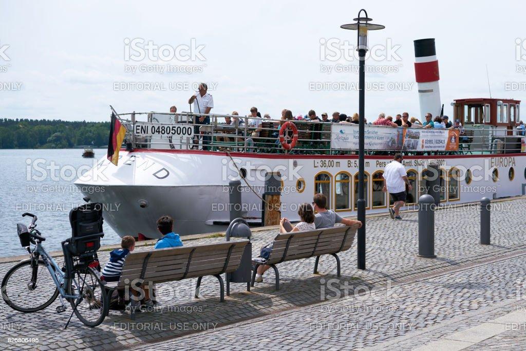 Pleasure boat in the port of Waren stock photo