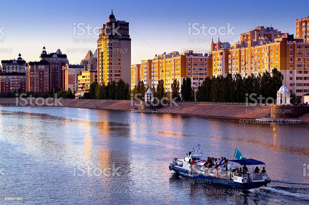 Pleasure boat on the river Ishim in Astana. Sunset stock photo