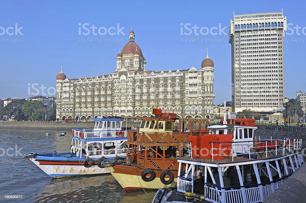 Pleasure boats and Taj at India Gate, Mumbai stock photo