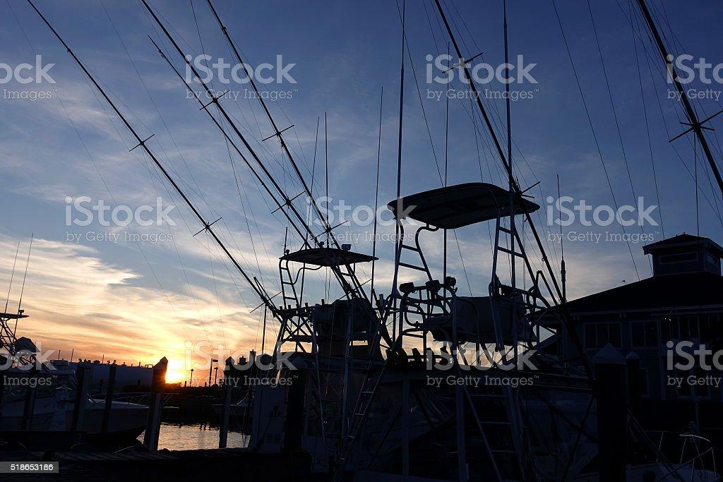 Pleasure boats at dusk stock photo