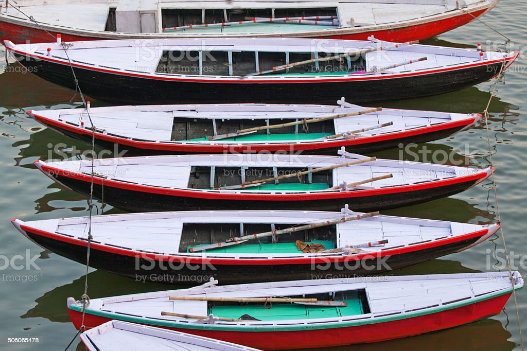 Pleasure boats moored on the banks of the Ganges ,Varanasi stock photo