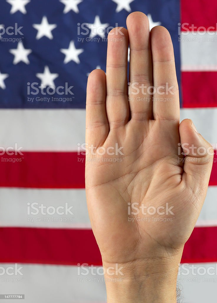 Pledging Hand in Front of American Flag royalty-free stock photo