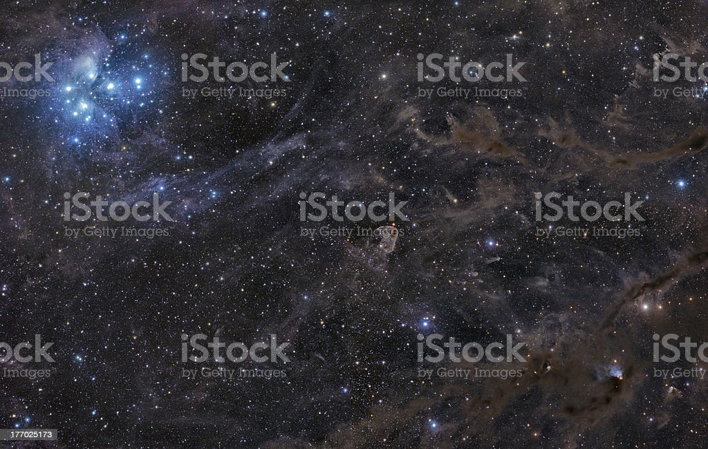 Pleiades in galactic dust royalty-free stock photo