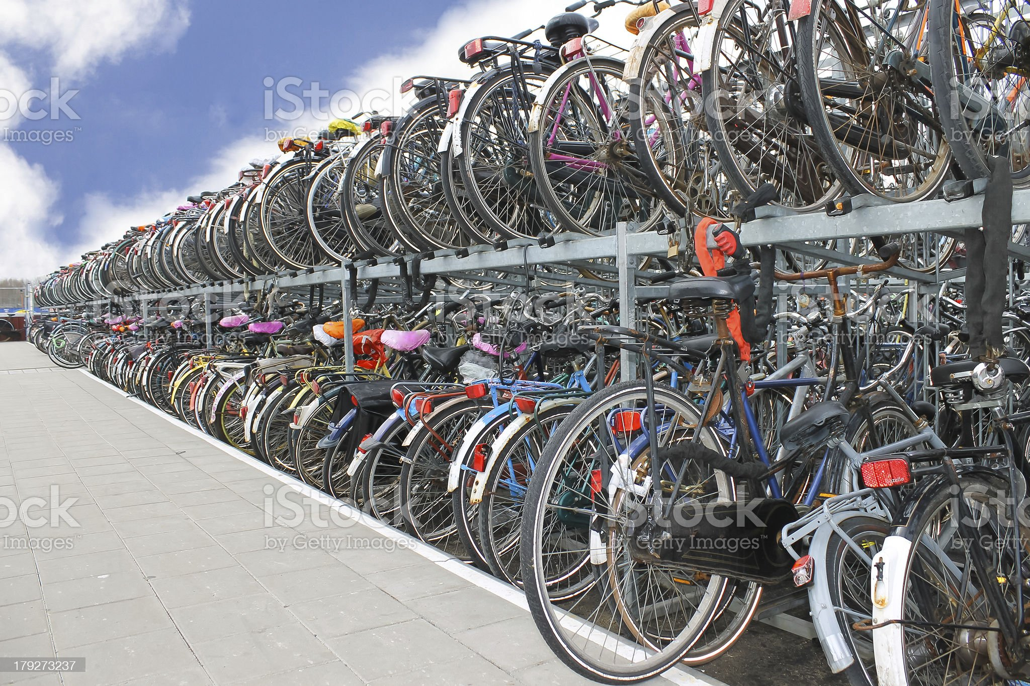 Plenty bicycles at parking lot in royalty-free stock photo