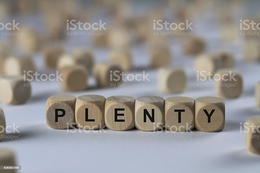 plenty - cube with letters, sign with wooden cubes stock photo