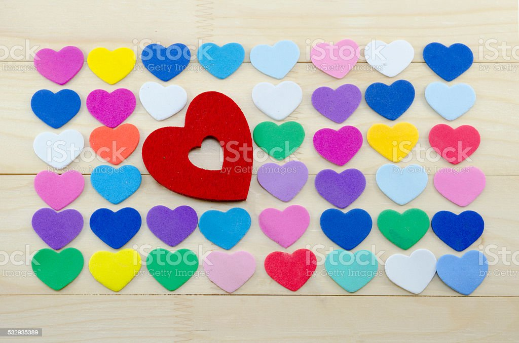 Plenty of colorful hearts on a wooden table royalty-free stock photo