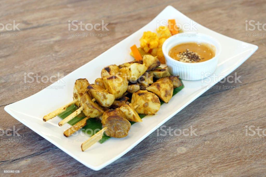 Pleurotus Eryngii Satay (King Oyster Mushroom) served with peanut sauce. stock photo