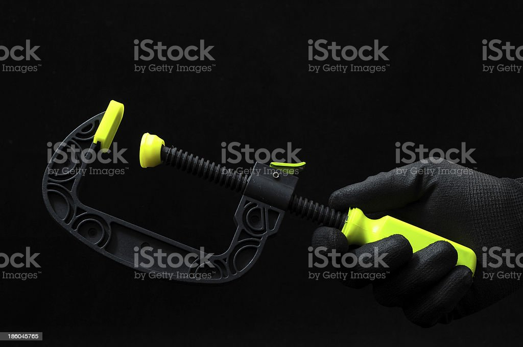 Pliers and a Hand royalty-free stock photo