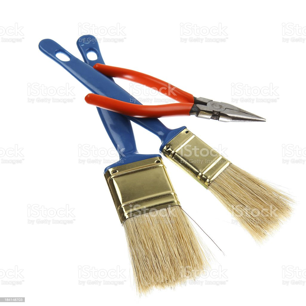 Pliers and paintbrushes royalty-free stock photo