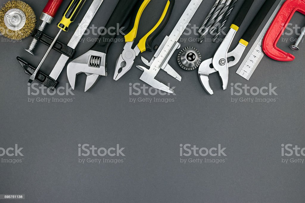 pliers, wrenches, ruler, clamp, vernier caliper on desk stock photo