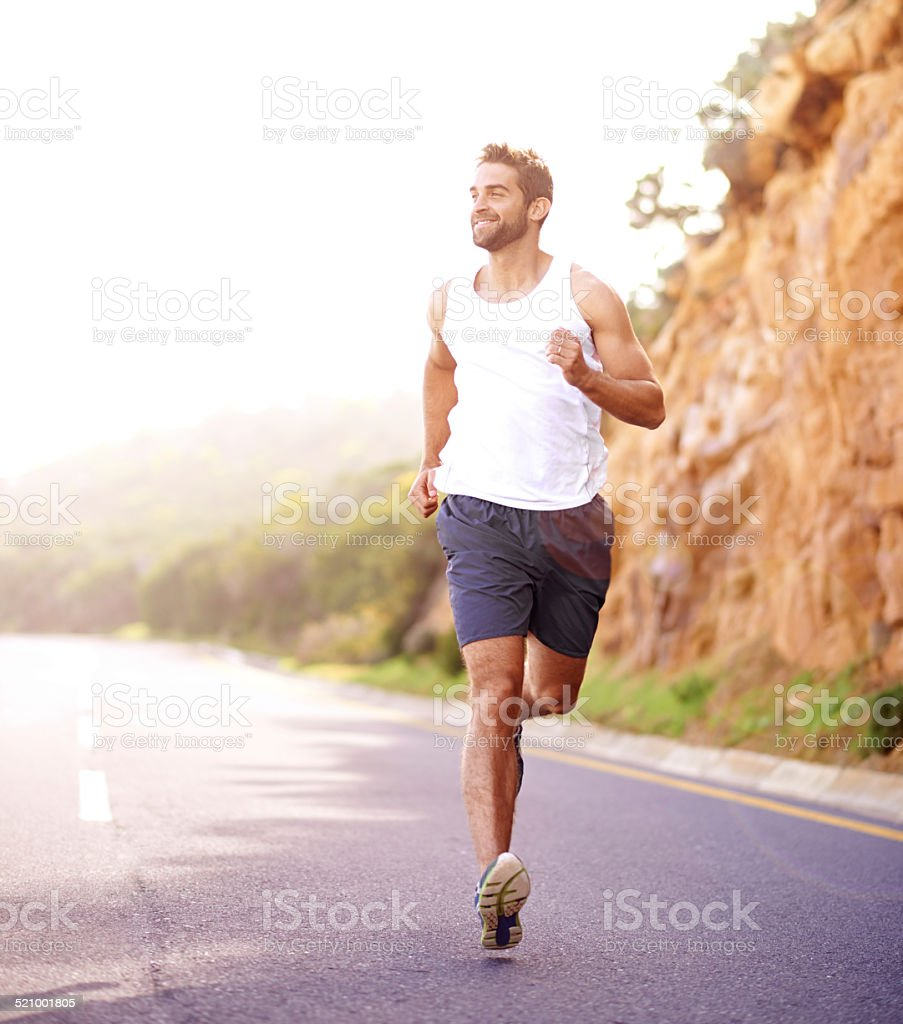 Plodding down the road of fitness stock photo
