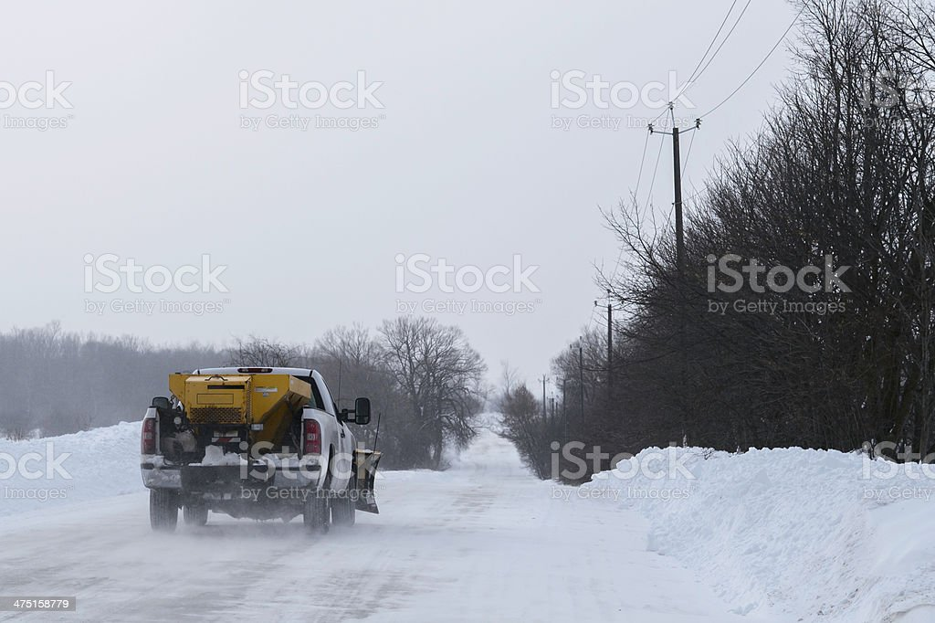 Plough Truck going down Snowy Road stock photo
