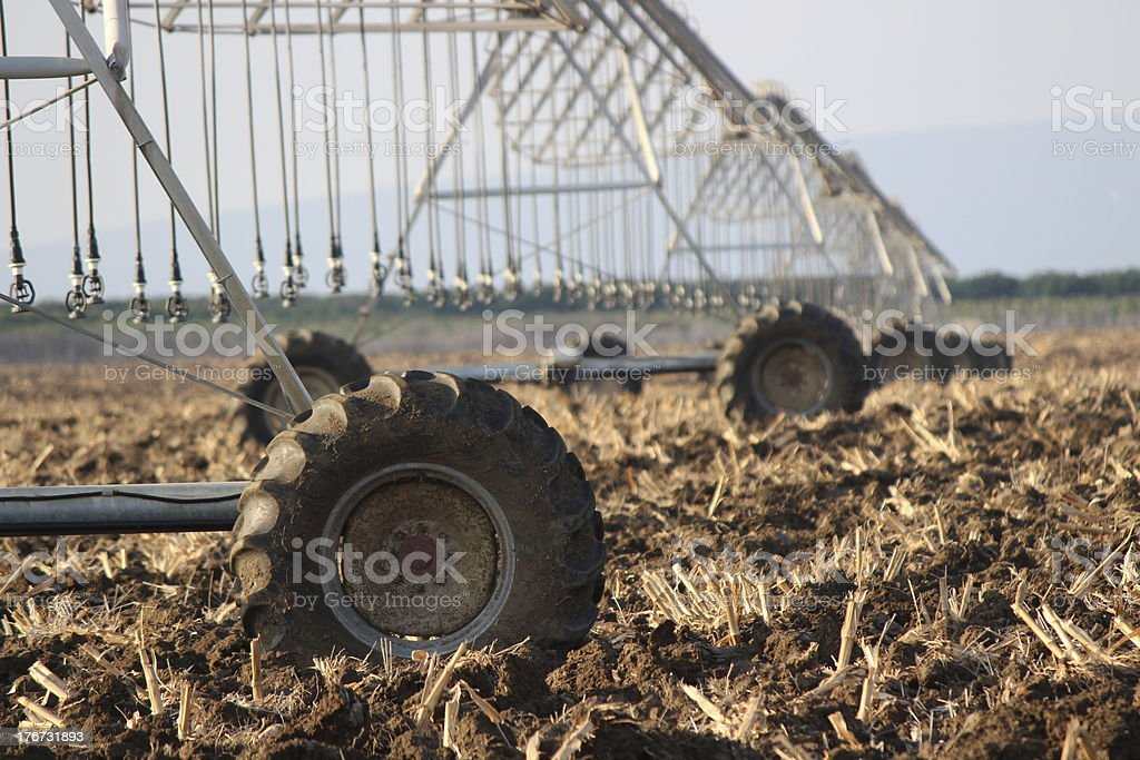 Ploughed earth with field irrigation system royalty-free stock photo