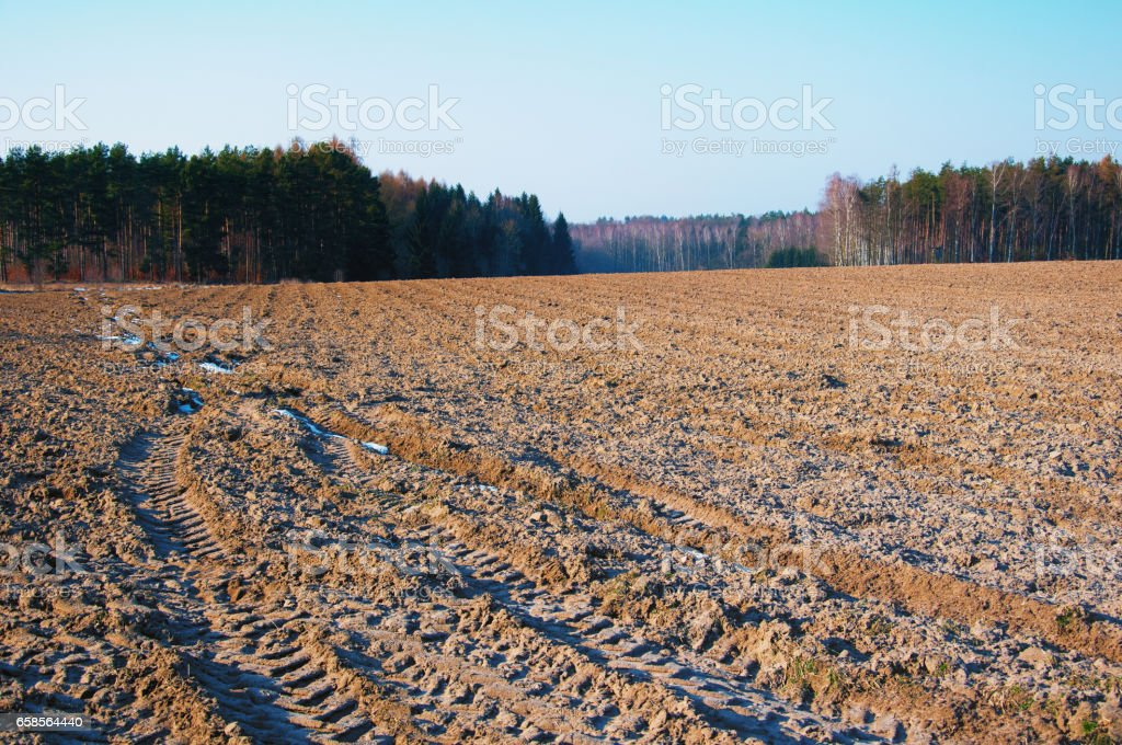 Ploughed field in autumn stock photo