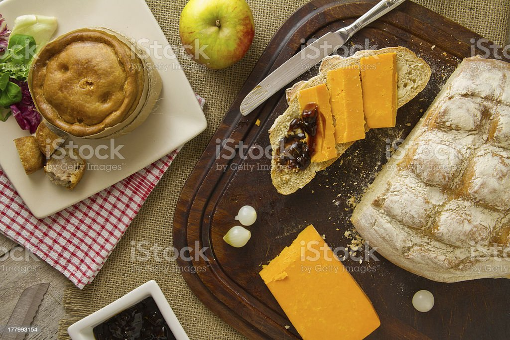Ploughman's Lunch Spread from above with cut bread stock photo