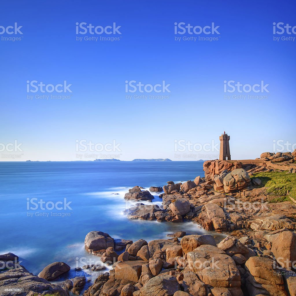 Ploumanach lighthouse sunset in pink granite coast, Brittany, France. stock photo