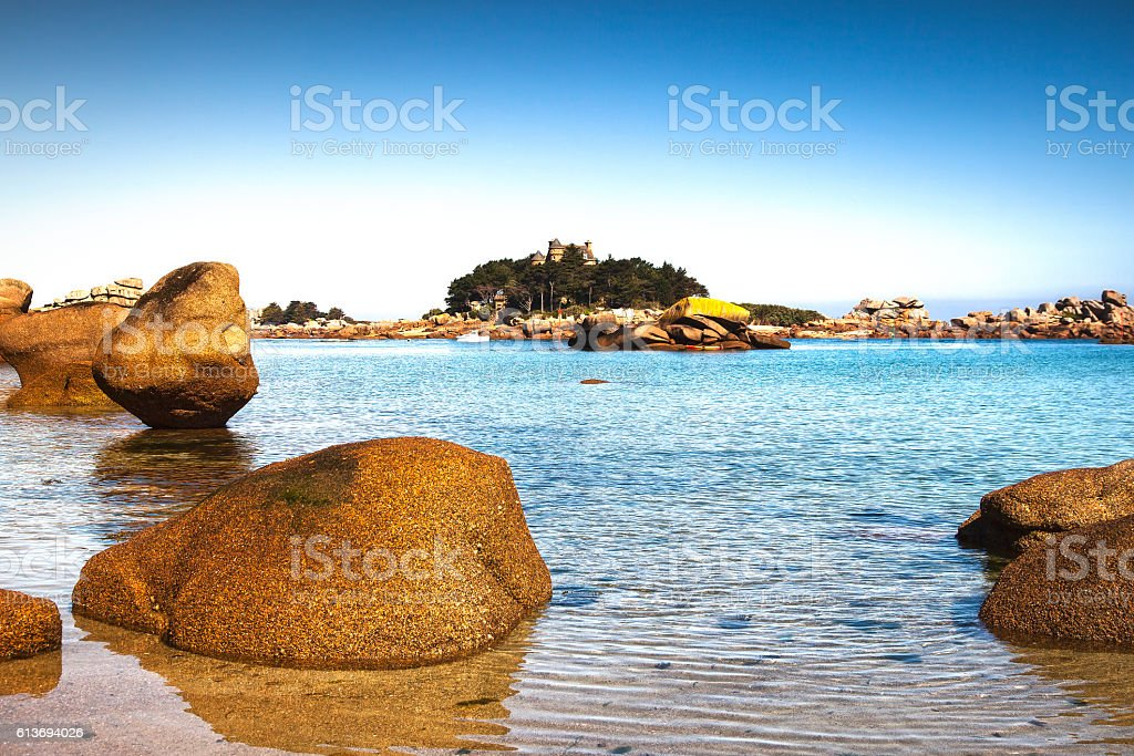 Ploumanach, rock and bay beach. Toned. Brittany, France. stock photo