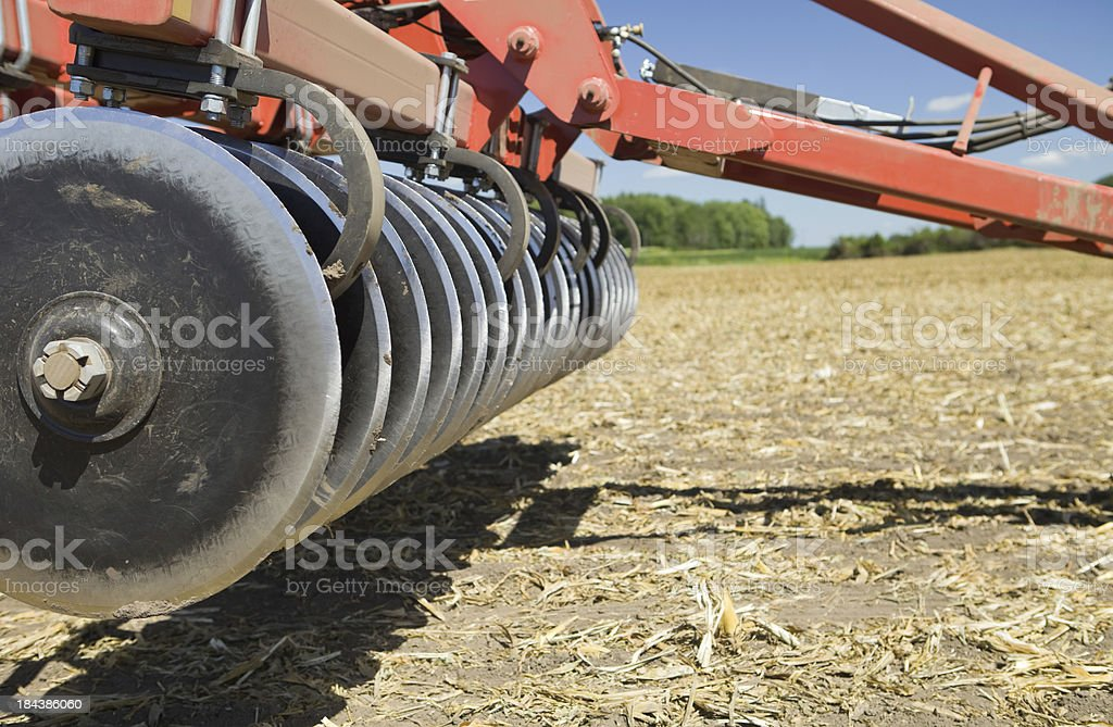 Plow in Harvested Corn Field Ready for Fall Tillage stock photo