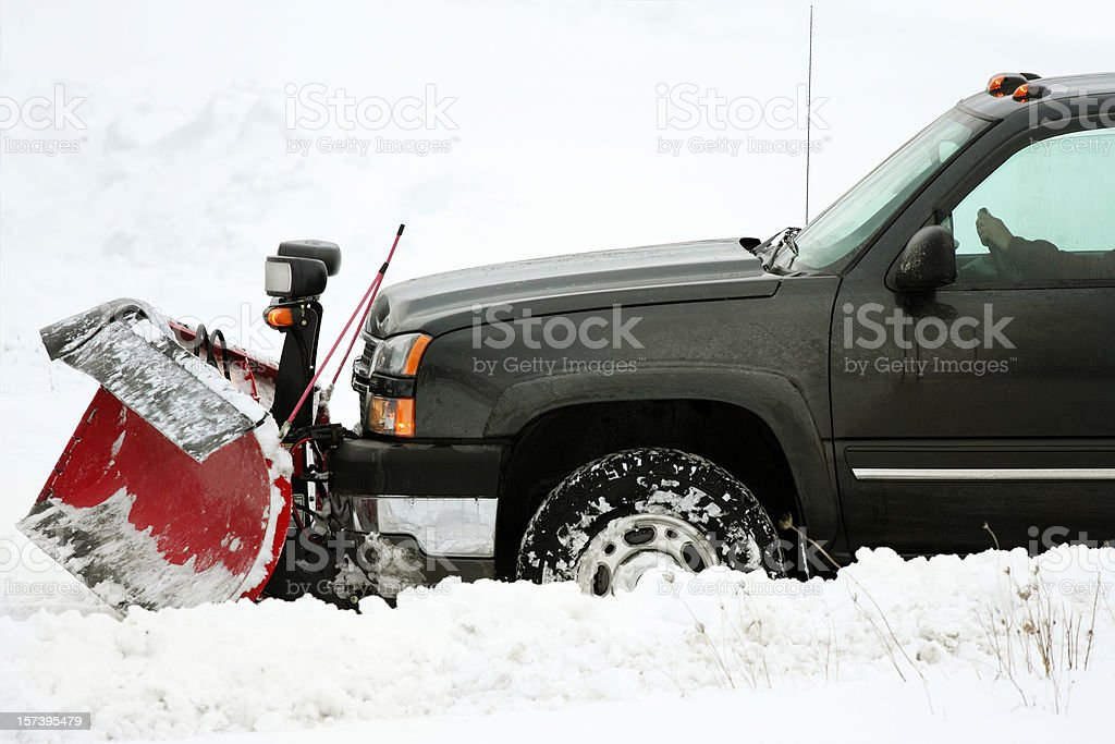 plow  removing snow on cold stormy day royalty-free stock photo