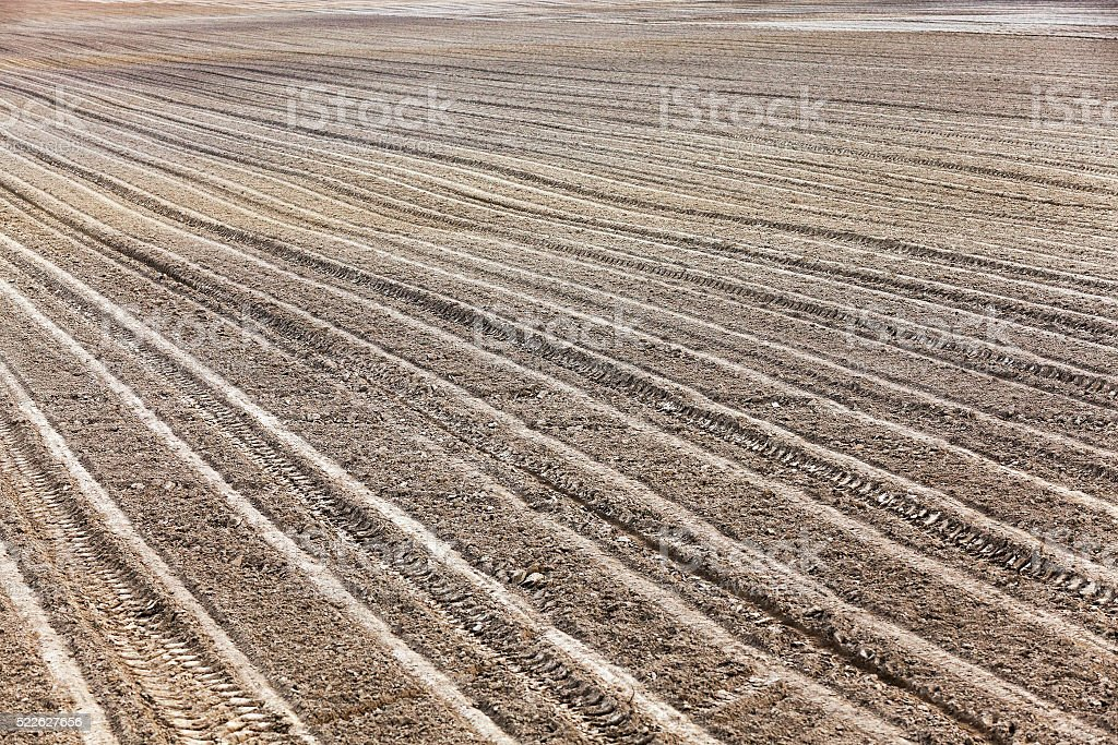 plowed agricultural field stock photo
