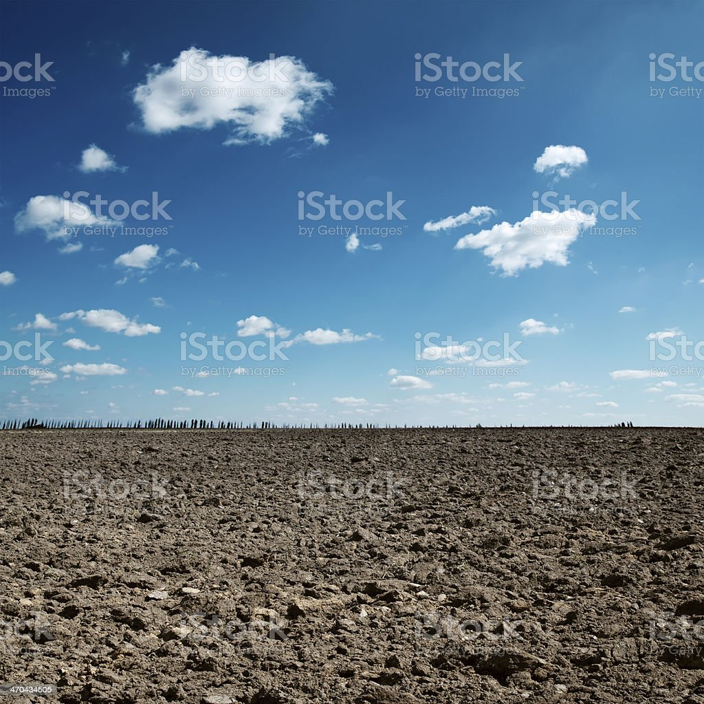 plowed field and blue sky stock photo