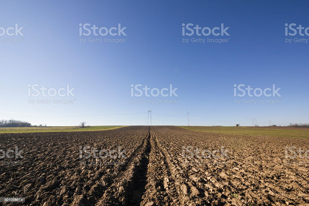 Plowed field on beautiful sunny morning stock photo