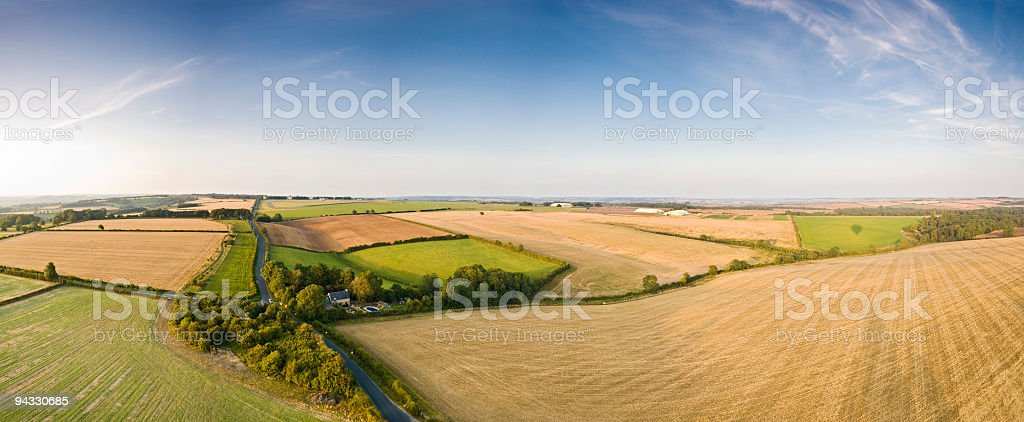 Plowed fields and pasture royalty-free stock photo