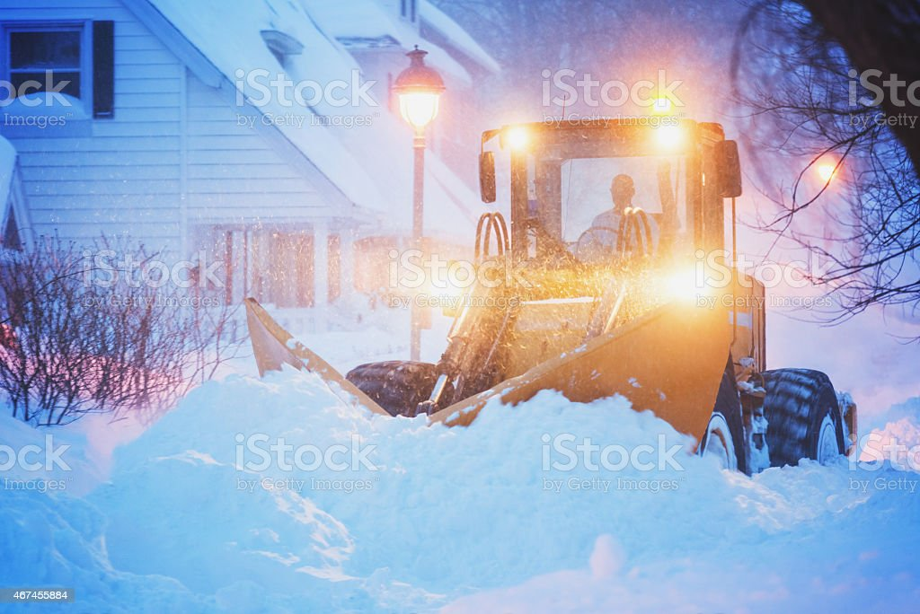 Plowing a City Street stock photo