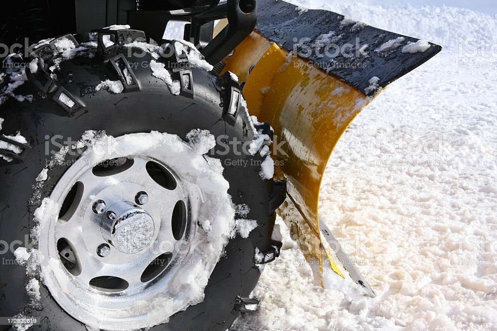 Plowing Snow with Blade Mounted on an ATV stock photo