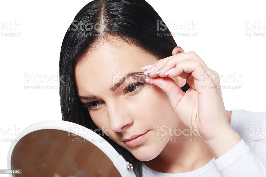 plucking tweezers brow stock photo