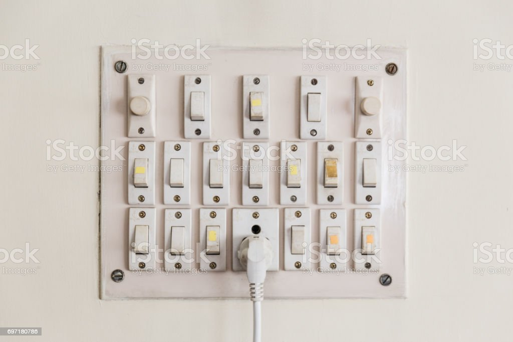 Plug and switches board on the wall's house in Kolkata, India stock photo