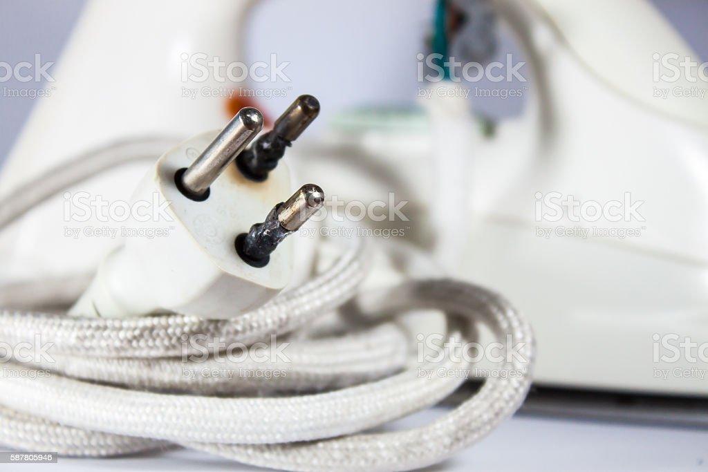 Plug form the iron burns overload stock photo