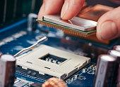 Plug in CPU microprocessor to motherboard socket.