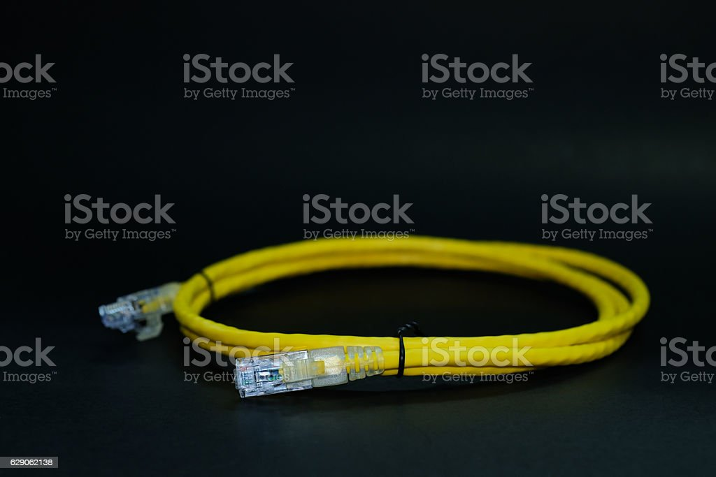 RJ45 Plug or Network cable. yellow Color. stock photo