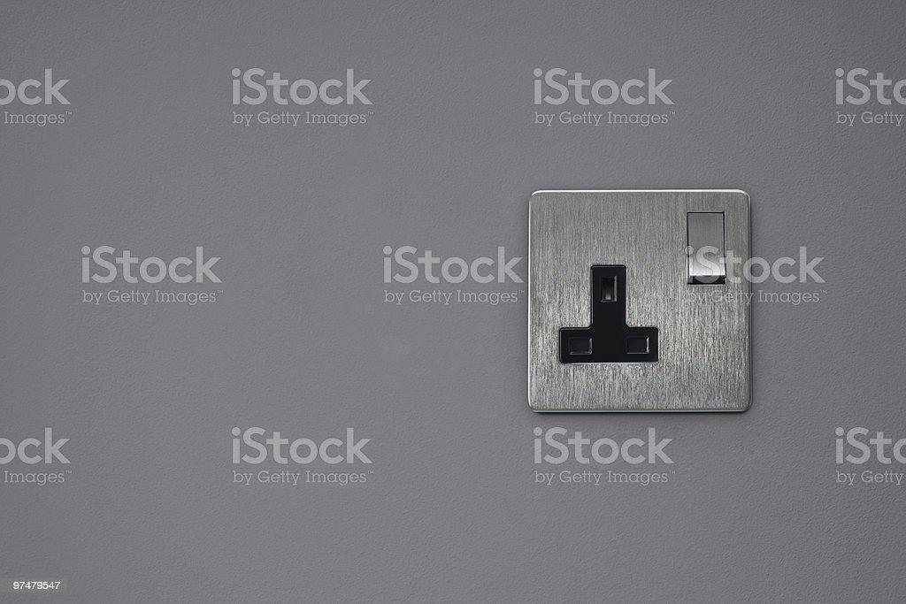 Plug socket on gray wall royalty-free stock photo