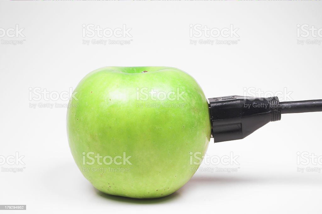 Plugged in Apple royalty-free stock photo