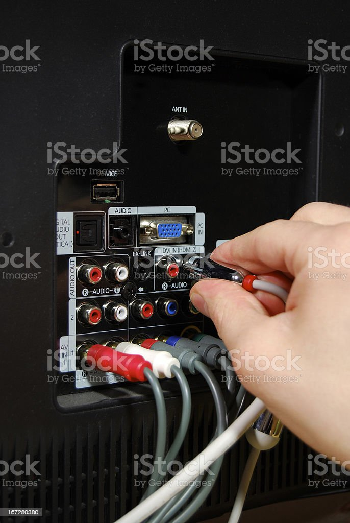 Plugging in Audio Cable royalty-free stock photo