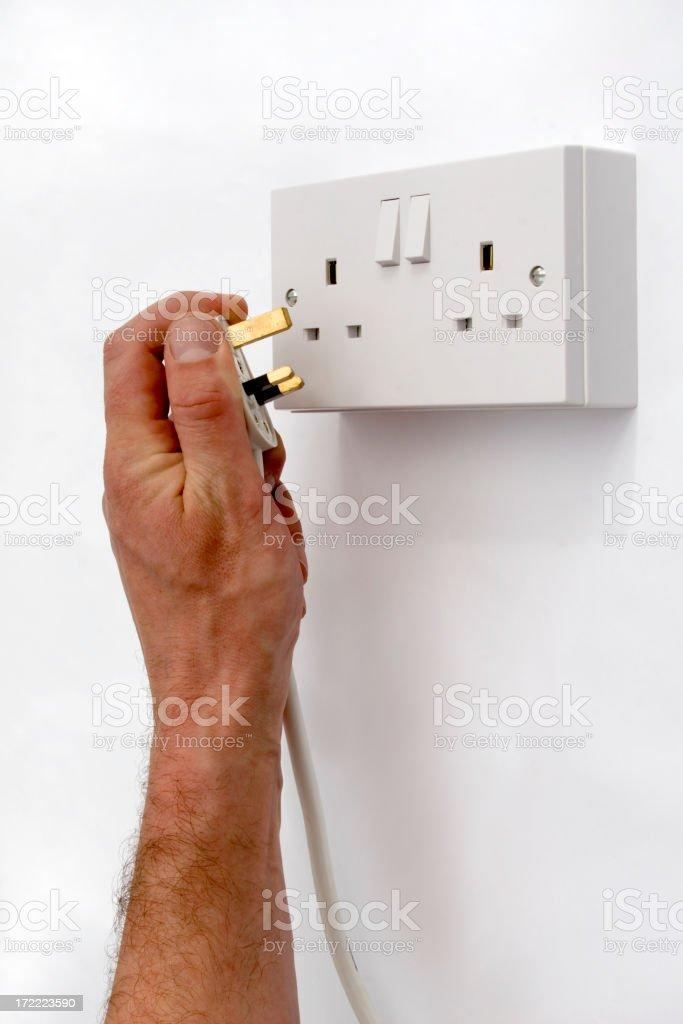 Plugging in British Plug royalty-free stock photo