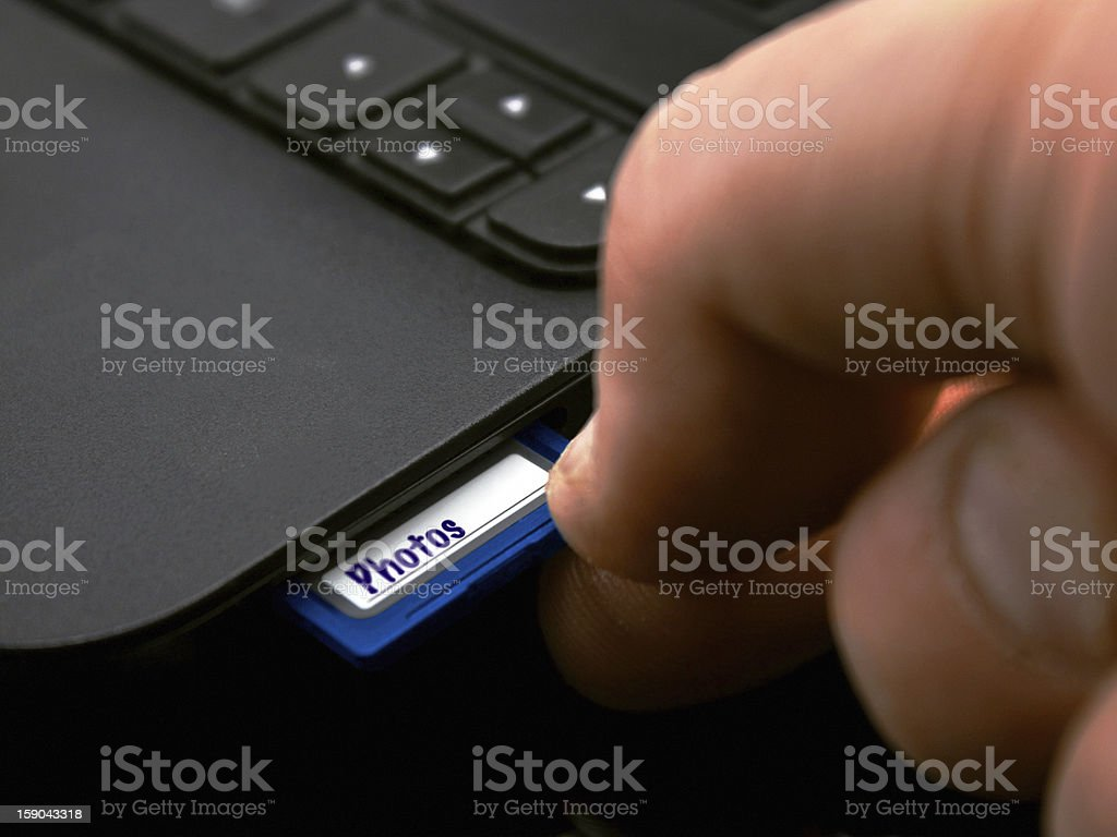 Plugging in SDhc memory Card stock photo