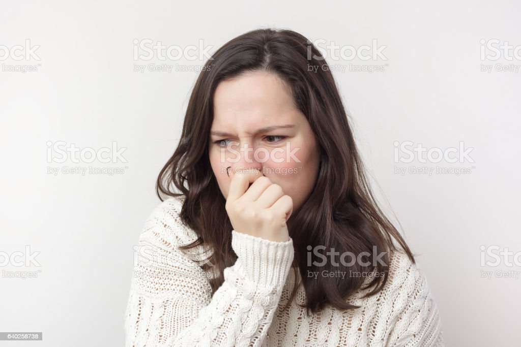 Plugging nose because of stinky smell stock photo
