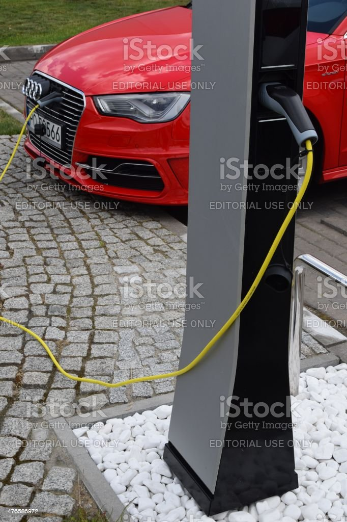 Plug-in hybrid Audi at the charging station stock photo