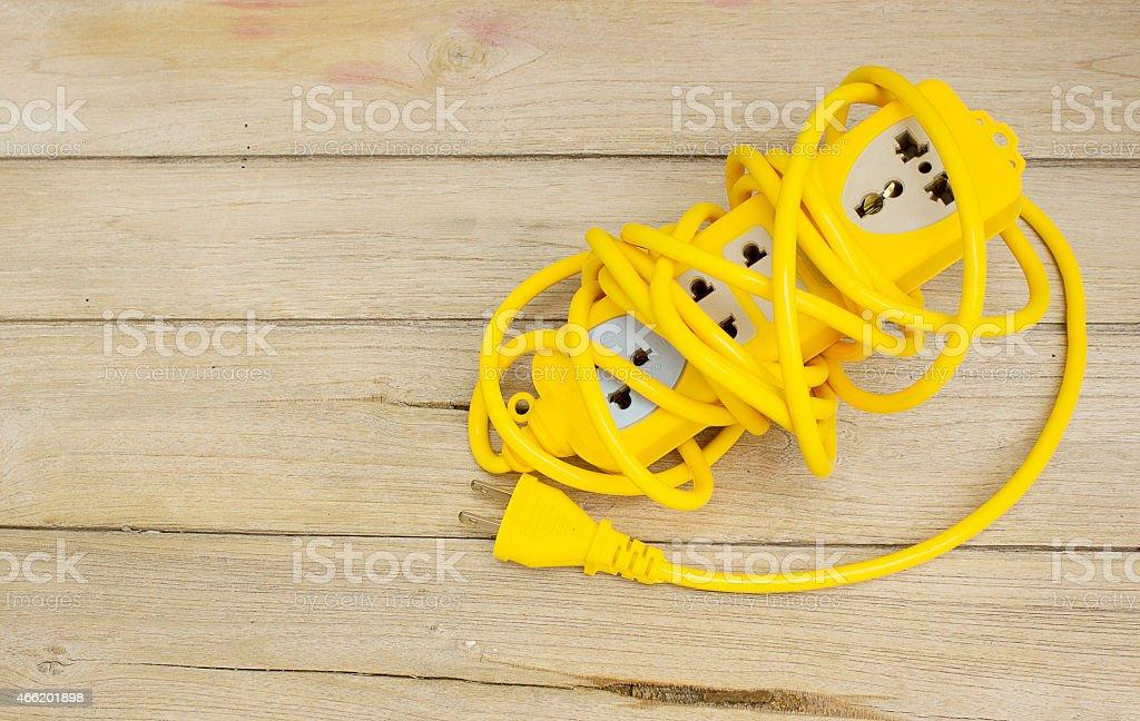 Plugs on wood stock photo