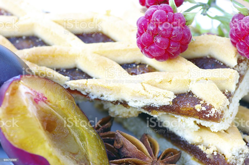 Plum cake with raspberry stock photo